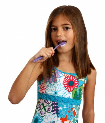 a-pretty-young-girl-brushing-her-teeth