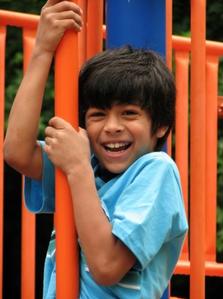 a-young-latino-boy-playing-on-a-playground